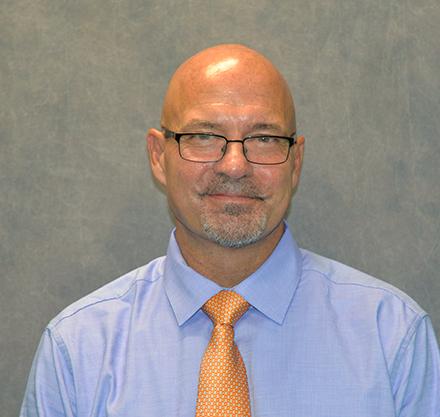 Dr. Greg Hawkins