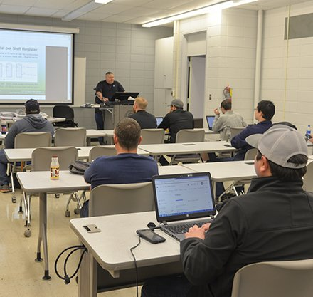 Brent Phillips addresses his electrical circuits class.