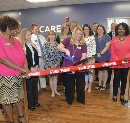 Karla Gilliam cuts the ribbon on the new CARE Planning Center at PTC.