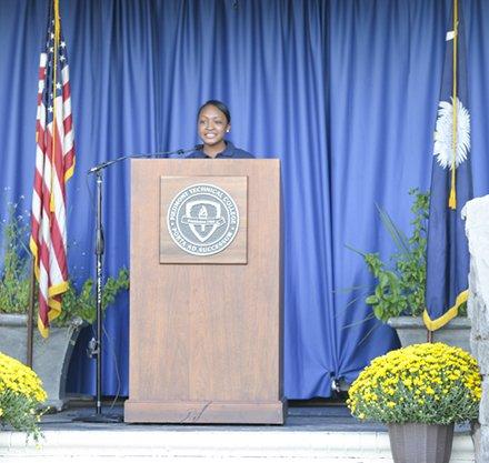 Presidential Ambassador gives speech.